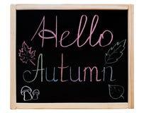 De inschrijving & x22; Hello Autumn& x22; geschreven op een bord in een houten kader, Royalty-vrije Stock Afbeelding
