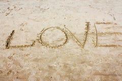 De inschrijving op het zand Stock Foto