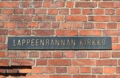 De inschrijving op muur van Kerk Lappeenranta Stock Foto's