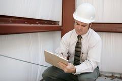 De Inspecteur van de bouw - Aantekening Royalty-vrije Stock Foto's