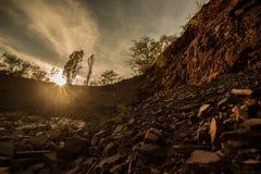 De instorting van de rots Zonsondergang Stock Foto