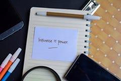 De invloed is machtswoord op papier wordt geschreven die de invloed is machtstekst op werkboek, technologie bedrijfsconcept royalty-vrije stock foto