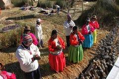 De inwoners van Uros, Peru Stock Foto