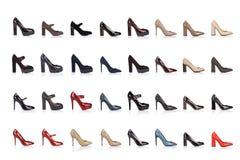 De inzameling van vrouwenschoenen op een witte achtergrond, met een schaduw op een glanzende oppervlakte Front View 32 stukken Stock Fotografie