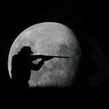 De jager en de volle maan van herten Royalty-vrije Stock Foto