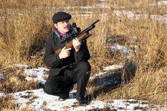 De jager van de winter stock afbeeldingen
