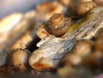 De jakobsschelp van de kip met paddestoel stock foto