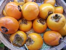 14 de janeiro de 2018, Kuala Lumpur Frutos frescos do caqui em Jaya Grocer Supermarket imagens de stock