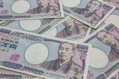 De Japans zaken van 10.000 Yenbankbiljetten en financiënconcept Royalty-vrije Stock Foto's