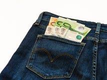 De jeans zijn kleingeld euro bankbiljetten en roebels Royalty-vrije Stock Fotografie