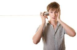 De jeugd met de Telefoon van het Blik van het Tin Stock Fotografie