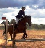 De jockey op een paard Stock Afbeeldingen