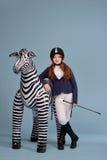 De jockeydromen van het roodharigemeisje van paarden Stock Foto