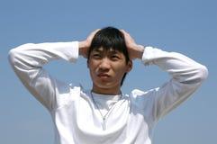 De Jonge Aziatische Mens van zorgen Stock Afbeelding