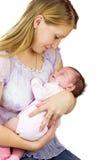 De jonge baby van de moederholding stock afbeeldingen
