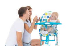 De jonge baby van het oudersvoer Stock Foto