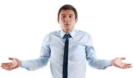 De jonge bedrijfsmens is verward Royalty-vrije Stock Foto