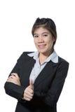 De jonge bedrijfsvrouw die duim op hand, bedrijfsconcept tonen van succes, goede baan, keurt goed, keurt goed, gaat en positief r Stock Fotografie