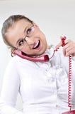 De jonge bedrijfsvrouw flirt op de telefoon. Royalty-vrije Stock Afbeeldingen