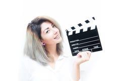 De jonge blauwe vrouw van het ogenblonde met filmklep royalty-vrije stock afbeeldingen