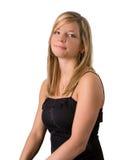 De jonge blonde zwarte kleding van het vrouwenportret royalty-vrije stock afbeeldingen