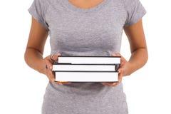 De jonge boeken van de schoolmeisjeholding Stock Fotografie