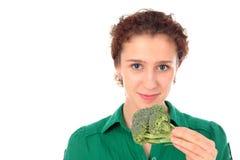 De jonge broccoli van de vrouwenholding royalty-vrije stock fotografie