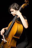 De jonge cello van vrouwenspelen Stock Fotografie