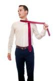 De jonge die mens verwijdert een kostuum op wit wordt geïsoleerd Zakenman of stude royalty-vrije stock fotografie