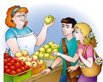 De jonge geitjes kopen appelen Stock Afbeeldingen