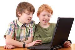 De jonge geitjes van de computer Stock Foto's