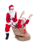 De jonge geitjes van de Kerstmisverrassing kleedden zich als santa en zijn helper Royalty-vrije Stock Foto's