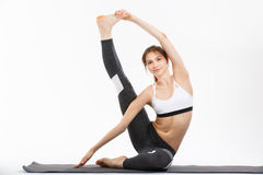 De jonge gesteunde yoga van de vrouwenoefening headstand Stock Afbeelding