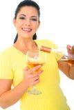 De jonge Gietende Wijn van de Vrouw royalty-vrije stock afbeelding