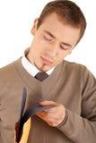 De jonge goed-geklede mens met wikkelt en dient in Stock Afbeeldingen