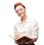 De jonge het glimlachen agenda van de bedrijfsvrouwenholding Stock Foto's