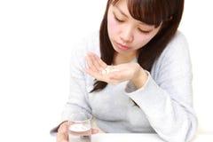 De jonge Japanse vrouw lijdt aan melancholie Stock Foto