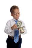 De jonge jongen kleedde zich aangezien de zakenman geld houdt Royalty-vrije Stock Afbeeldingen