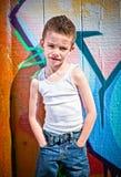 De jonge jongen met dient zakken in Stock Afbeelding