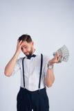 De jonge kerel schokte zijn inkomens Royalty-vrije Stock Foto's