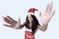De jonge Kerstmisvrouw toont witte achtergrond Royalty-vrije Stock Afbeelding