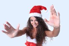 De jonge Kerstmisvrouw toont witte achtergrond Stock Afbeeldingen