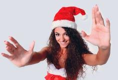 De jonge Kerstmisvrouw toont witte achtergrond Royalty-vrije Stock Foto