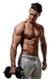 De jonge knappe broek die van bodybuilder shirtless sporten stom houden Royalty-vrije Stock Fotografie