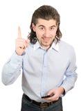 De jonge knappe mens glimlacht en zwiept met geïsoleerde vinger Royalty-vrije Stock Foto's