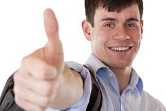 De jonge knappe student toont het glimlachen duim Stock Foto's