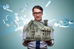 De jonge knappe zakenman in hypotheekconcept Stock Fotografie