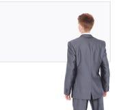 De jonge knappe zakenman isoleerde witte achtergrond Stock Afbeelding