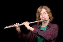 De jonge man speelt een fluit Stock Fotografie