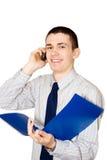 De jonge man spreekt om te telefoneren royalty-vrije stock afbeelding